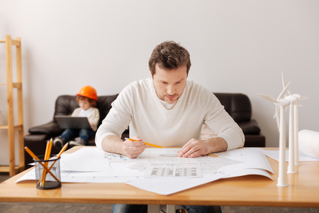 figuring: Very attentive engineer figuring on result Stock Photo