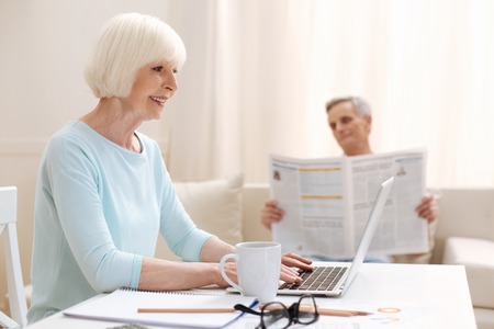 information age: Ambitious active elderly lady working as a freelancer
