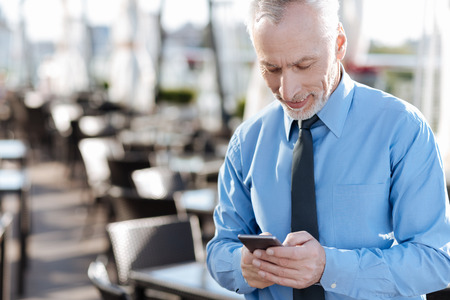 manhood: Positive delighted worker answering on message Stock Photo