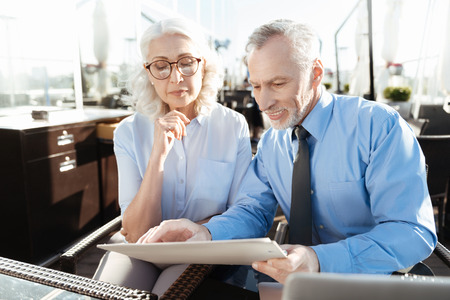 Attentive woman looking downwards at folder Stock Photo