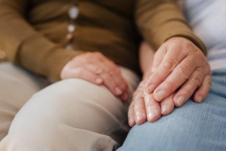 manhood: Happy woman keeping hand of her husband Stock Photo