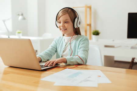 Cute excited girl wearing headphones Stock Photo