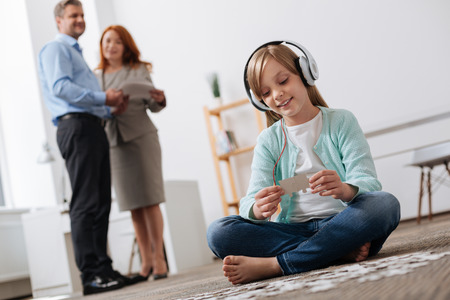 Smart lovely girl playing developing games Stock Photo