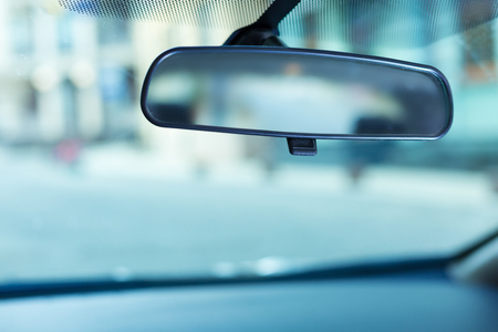 Rear-view mirror adjusted to the windshield 版權商用圖片