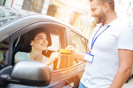 Car rental agency employee receiving a credit card