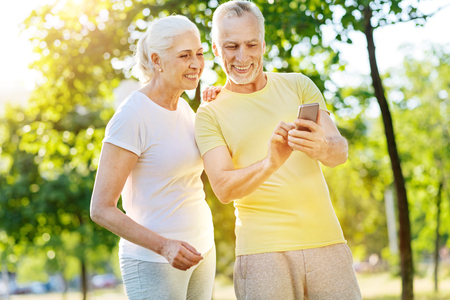 Positive aged couple resting in the park Stock Photo