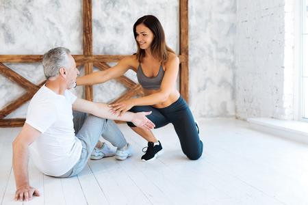 Mature male person training with instructor