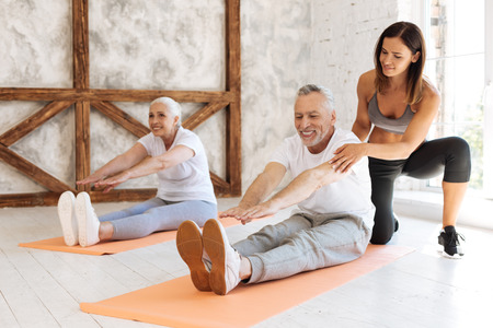 Delighted man doing sport exercises with pleasure Stock Photo