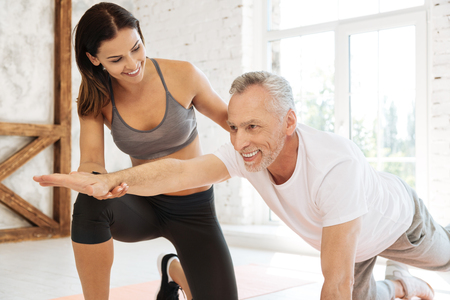 Positive delighted man doing exercises with pleasure Stock Photo
