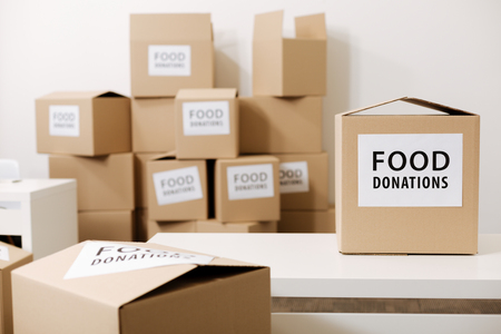 Grey boxes with food for those in need Stock Photo