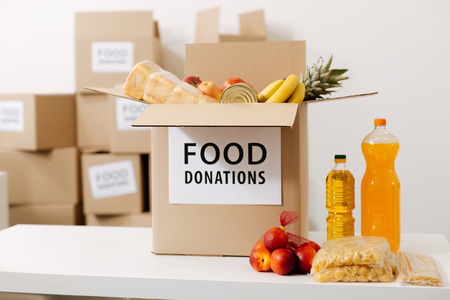 Light grey box being filled with foods Stock Photo