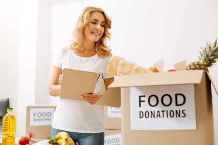 Energetic scrupulous woman making sure all products are packed