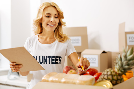 Diligent stunning woman keeping supplies in check