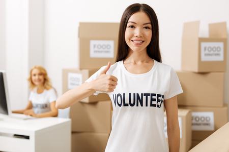 Devoted gorgeous girl enjoying her volunteering experience