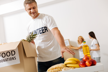 Motivated intelligent man working for charity Stock Photo