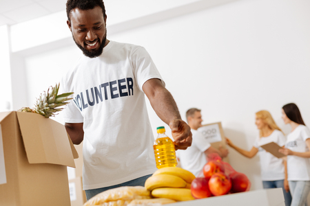 Nice enthusiastic man happy helping for free Stock Photo