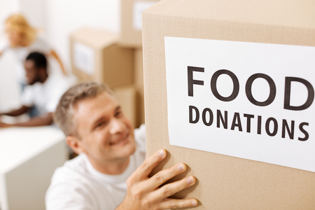 Dedicated generous man shipping supplies for the poor Stock Photo