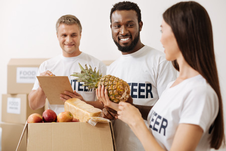 Extraordinary positive people making their contribution Stock Photo