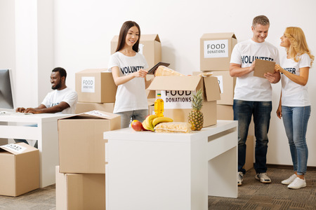 Nice brilliant woman examining the contents of package Stock Photo