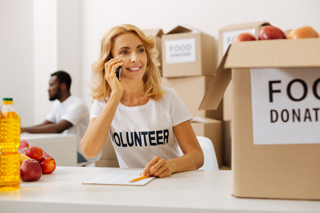 Active productive woman calling from charitable organization office