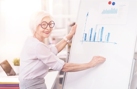 gerontology: Experienced clever businesswoman developing a strategy