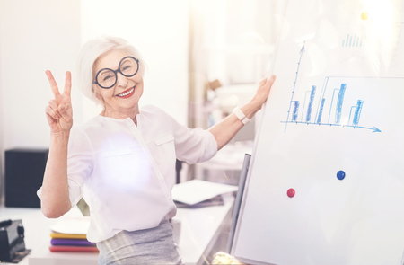 gerontology: Positive talented business lady having fun in the office