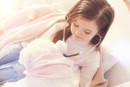 Pretty child imagining that she is nurse