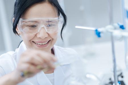Happy cheerful scientist smiling