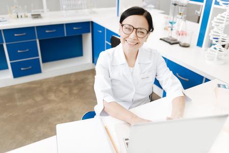 genomics: Happy professional scientist looking at you