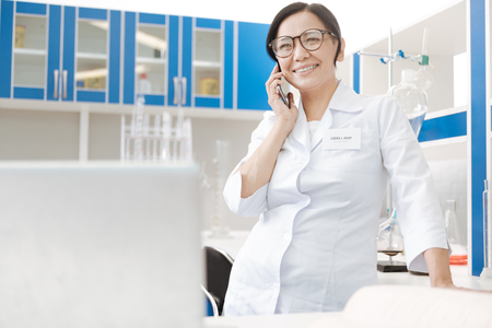 up code: Cheerful good looking woman making a call