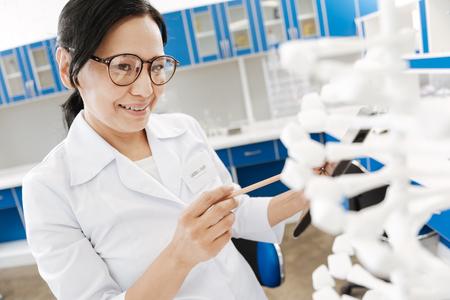 Intelligent female researcher studying genomics Stock Photo