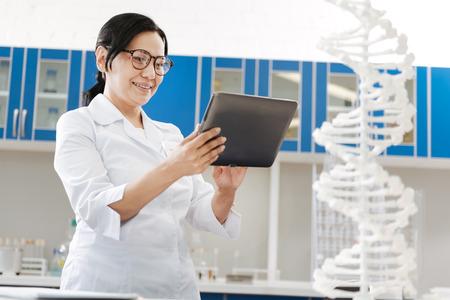 genomics: Delighted smart woman doing her job