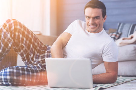 Confident man while using laptop