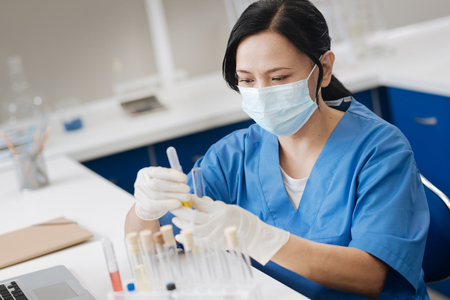 Professional lab working wearing a surgical mask