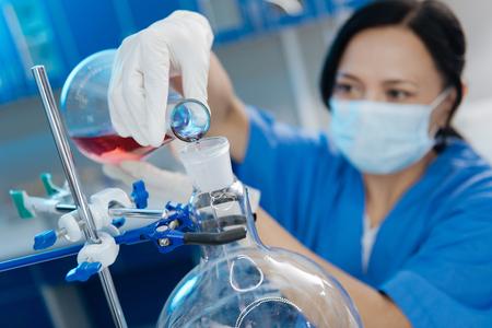 Positive smart chemist pouring liquid