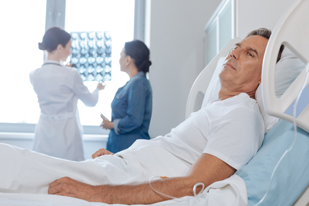 female catheter: Depressed unhappy man being a patient at the hospital Stock Photo
