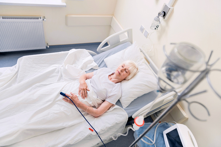 gerontology: Feeble senior woman resting while recovering