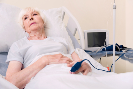 Sad fragile aged woman getting better after disease Stock Photo