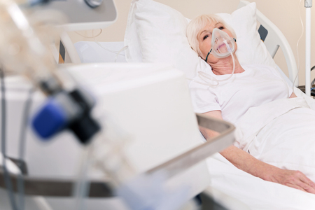better: Vulnerable sore woman feeling better after a stroke Stock Photo