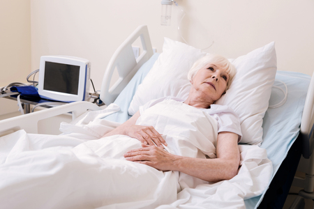 Vulnerable worried woman feeling lonely in hospital Stock Photo