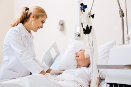 Caring gentle doctor making her patient feeling like at home Stock Photo