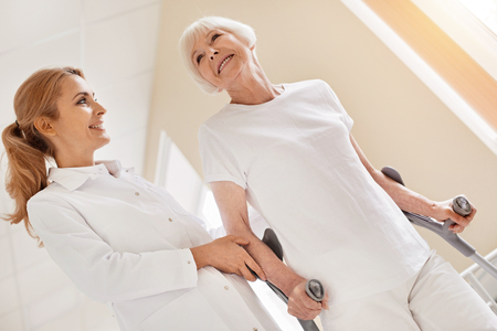 Vibrant elderly woman doing well during rehabilitation