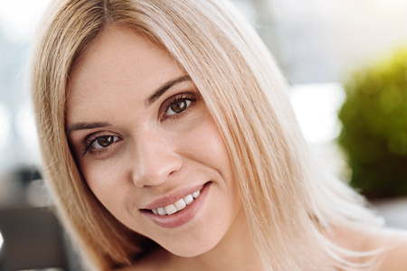 Delighted young woman smiling