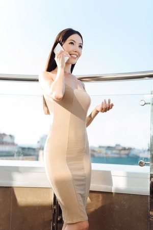 Attractive magnetic woman having a phone conversation