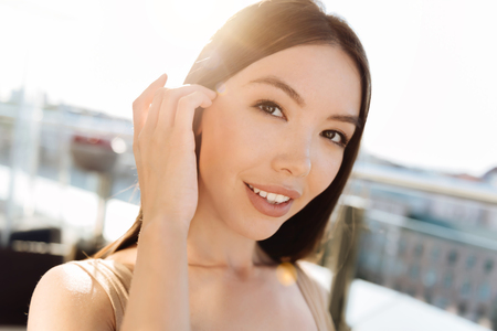 Charming attractive woman looking at you Stock Photo
