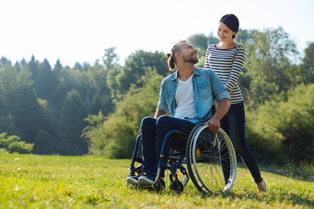 Man with disabilities and his wife exchanging loving looks