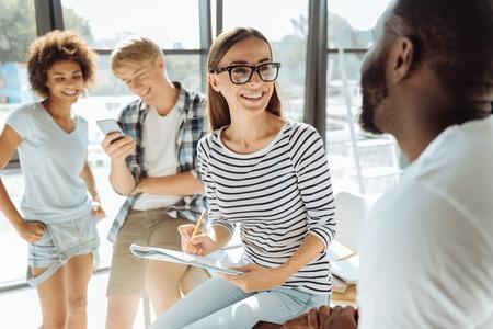 Positive international students talking together Standard-Bild