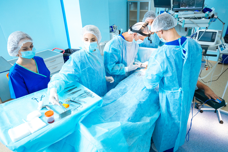 Group of professional medical workers treating patient