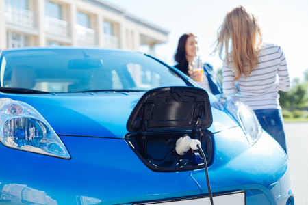Selective focus of an electric charger plugged into the car