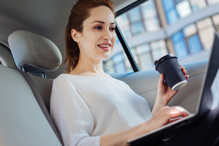 Attractive successful businesswoman holding a cup of coffee